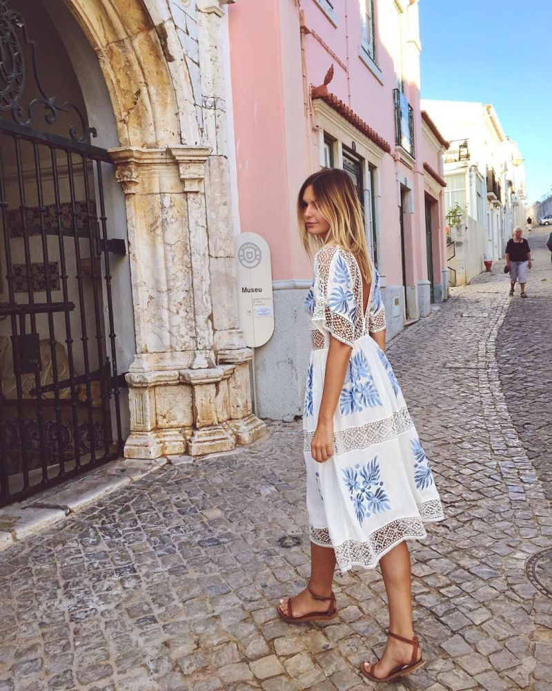 Photo of girl in printed blue/white dress and sandals