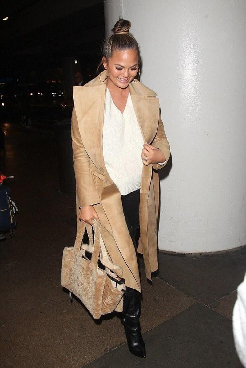 Chrissy Teigan carrying a fur celine bag