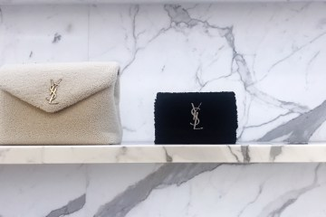 photot of saint laurent beige sherpa bag and black sherpa bag at bergdorf goodman in nyc