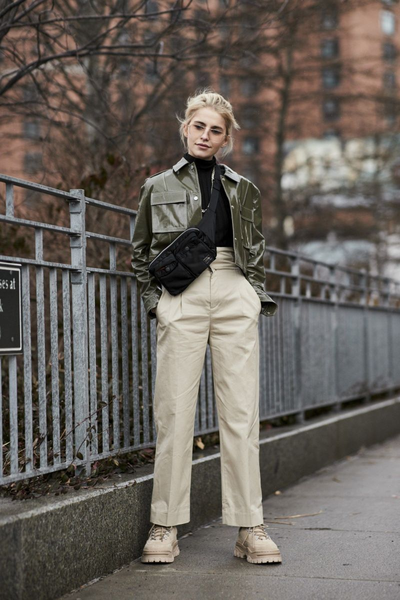 Street style shot of caroline daur in patent green jacket