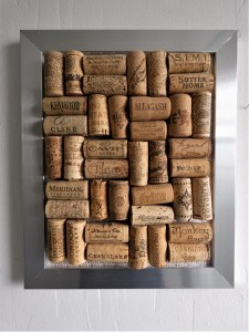 Several wine bottle corks packed into a picture frame