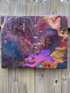 swirling rainbow colors to make a galaxy pattern of reds, blues, pinks, and greensfeaturing a pink and purple octopus at the bottom