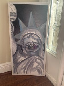 A painting of the statue of liberty with graffiti painted over the face