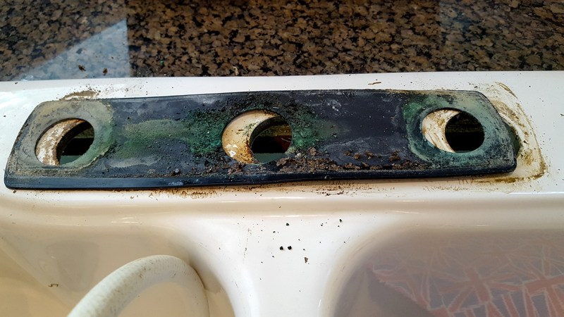 Old white faucet to be replaced by Pfister Tayga Faucet in Slate