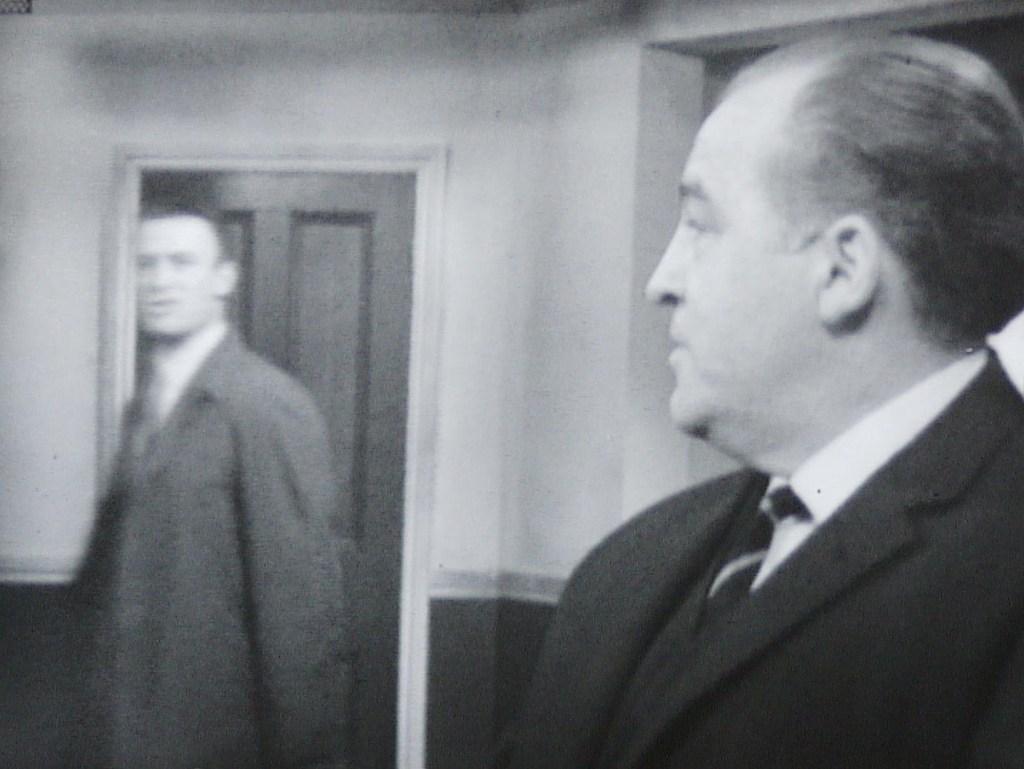 Callan heading to a door as Hunter looks over