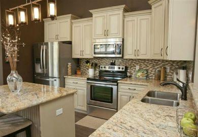White Kitchen Cabinets With White Spring Granite