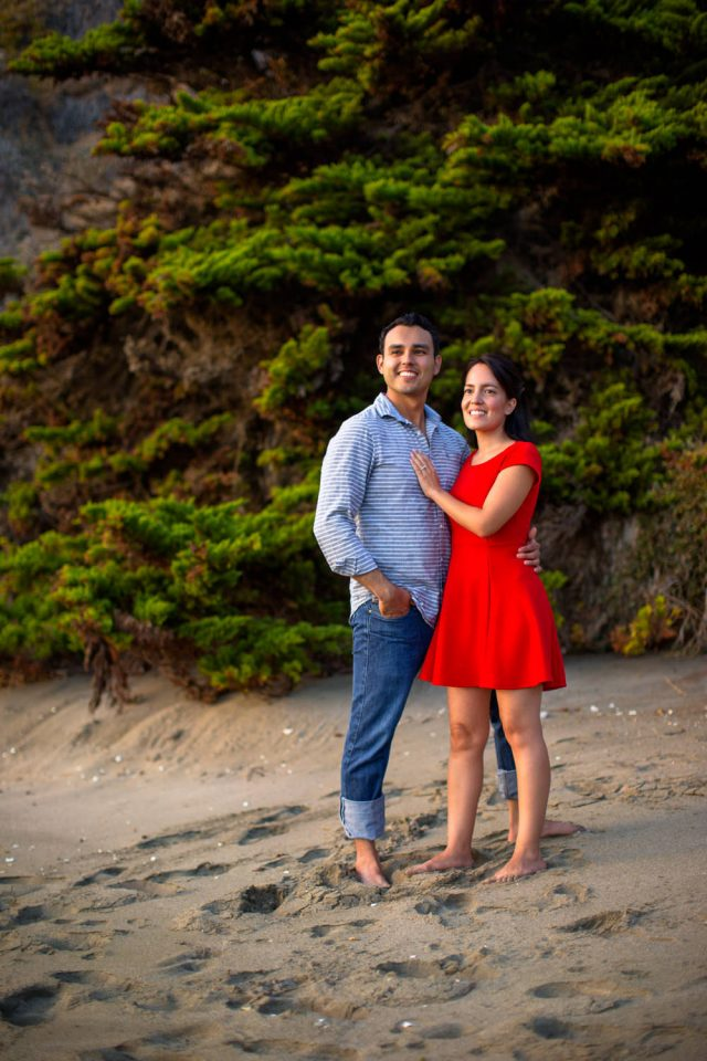 Couple looking off into distance as part of their Laguna Beach engagement session