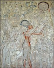 Akhenaten and his family worshiping Aten. Cairo Museum.