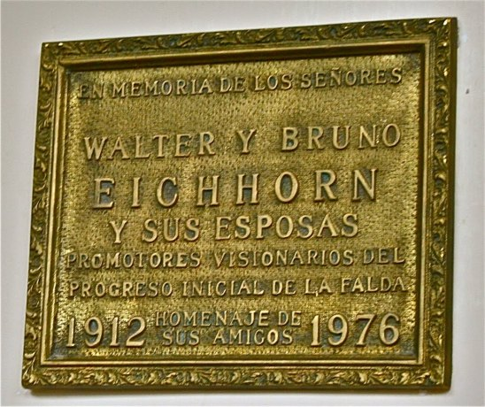 A plaque remembers the husbands by name and the wives by association, naturally.