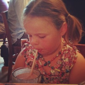 Tallulah enjoying a smoothie at Cafe Green