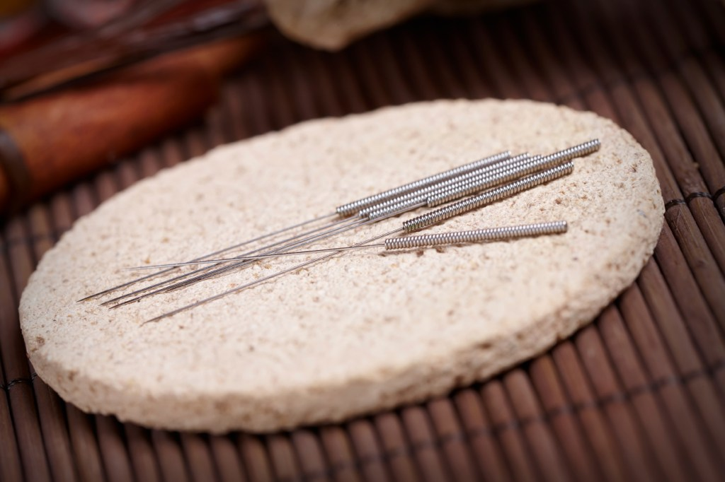 Acupuncture needles on the stone mat