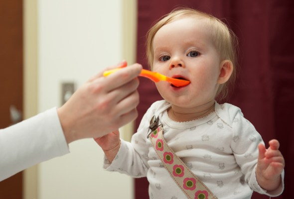 Feeding baby healthy food.