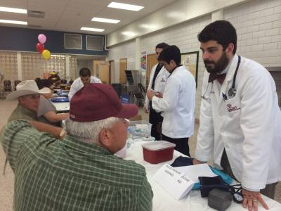 Bryan Donald, third-year professional student pharmacist at the Texas A&M Health Science Center Irma Lerma Rangel College of Pharmacy, volunteers at a service learning event.