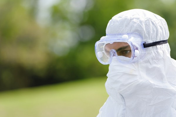 Man in PPE suit