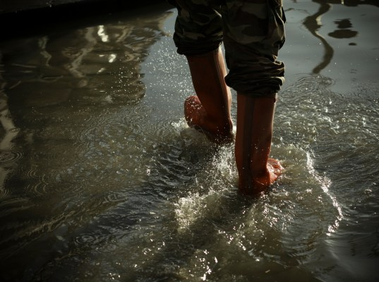 Person walking through heavy water