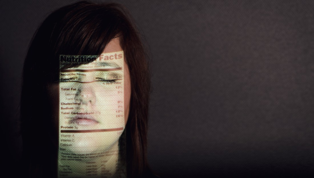 Woman with nutrition label on her face