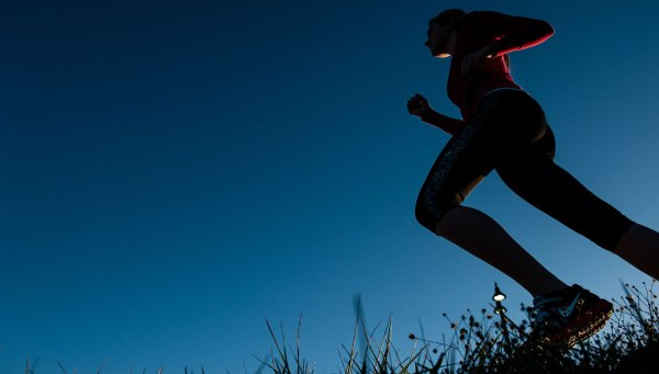 Girl running on the grass
