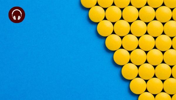 Pills on blue background