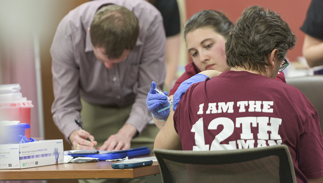 Flu Vaccine Clinic_A student administers a flu shot to a Texas A&M employee