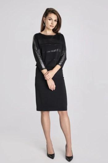 Linia wizytowa. Wyrzucana czarna sukienka wizytowa z błyszczącymi wstawkami i lampasem polskiej marki Vito Vergelis