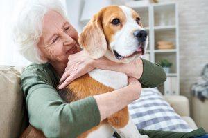 retired lady hugging her dog