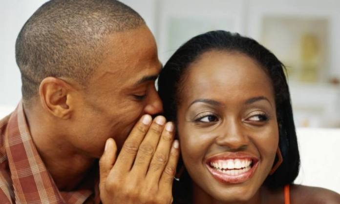 black-man-whispering-woman-ears