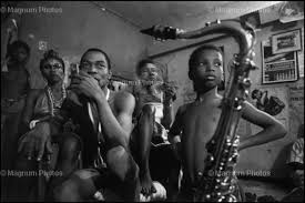 Fela pictured with his first Son, Femi, who is seen carefully manning the trumpet here