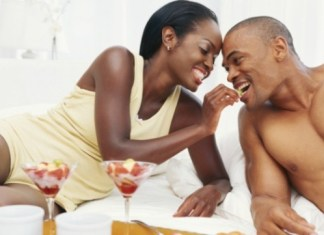 Nigerian relationships - Black woman feeding black man