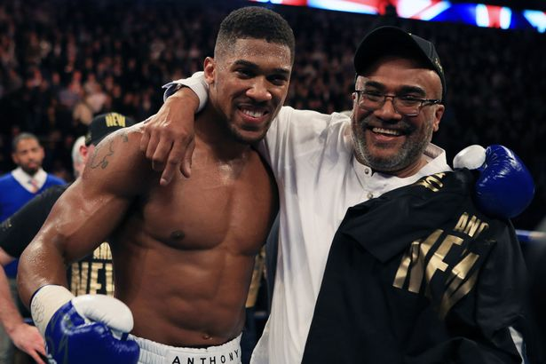 Anthony-Joshua-celebrates-with-his-father-Jonathan-after-beating-Charles-Martin