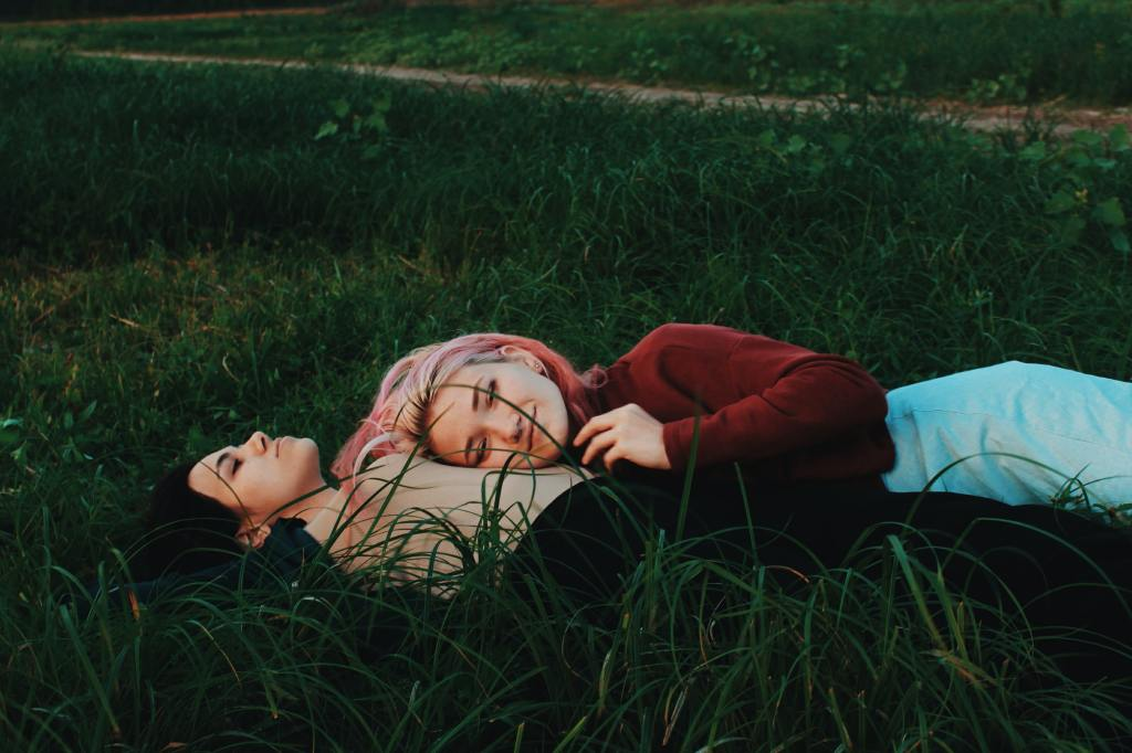 intimate moment of couple laying in grass