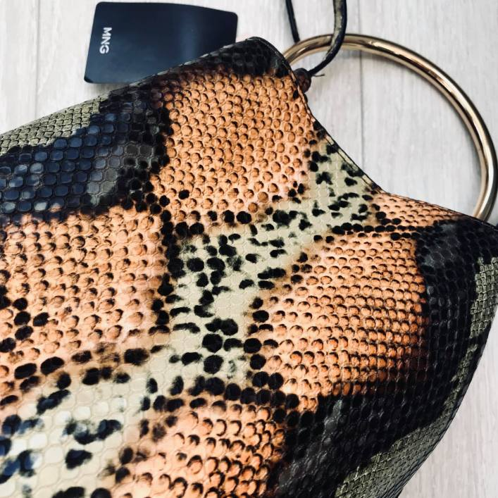 gold handle snake skin bag
