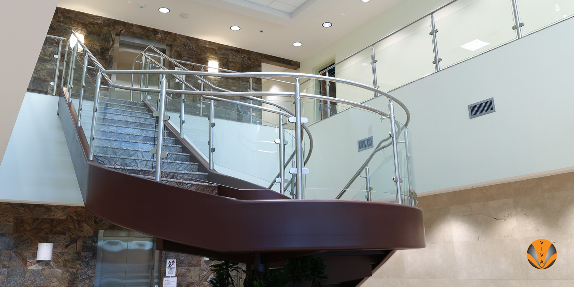 Curved Glass Railing System Circa™ Genusys Corporation | Curved Glass Stair Railing | Residential Glass | Commercial Glass | Band Glass | Walnut | Frameless Glass
