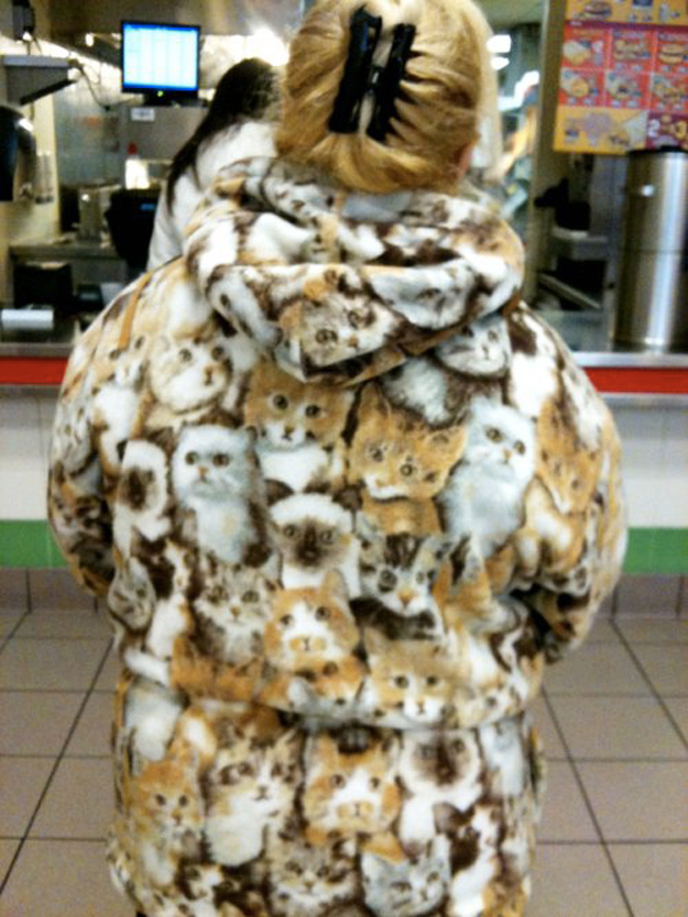 This woman wearing a cat coat.