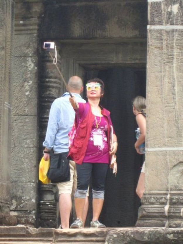 This woman taking a selfie.