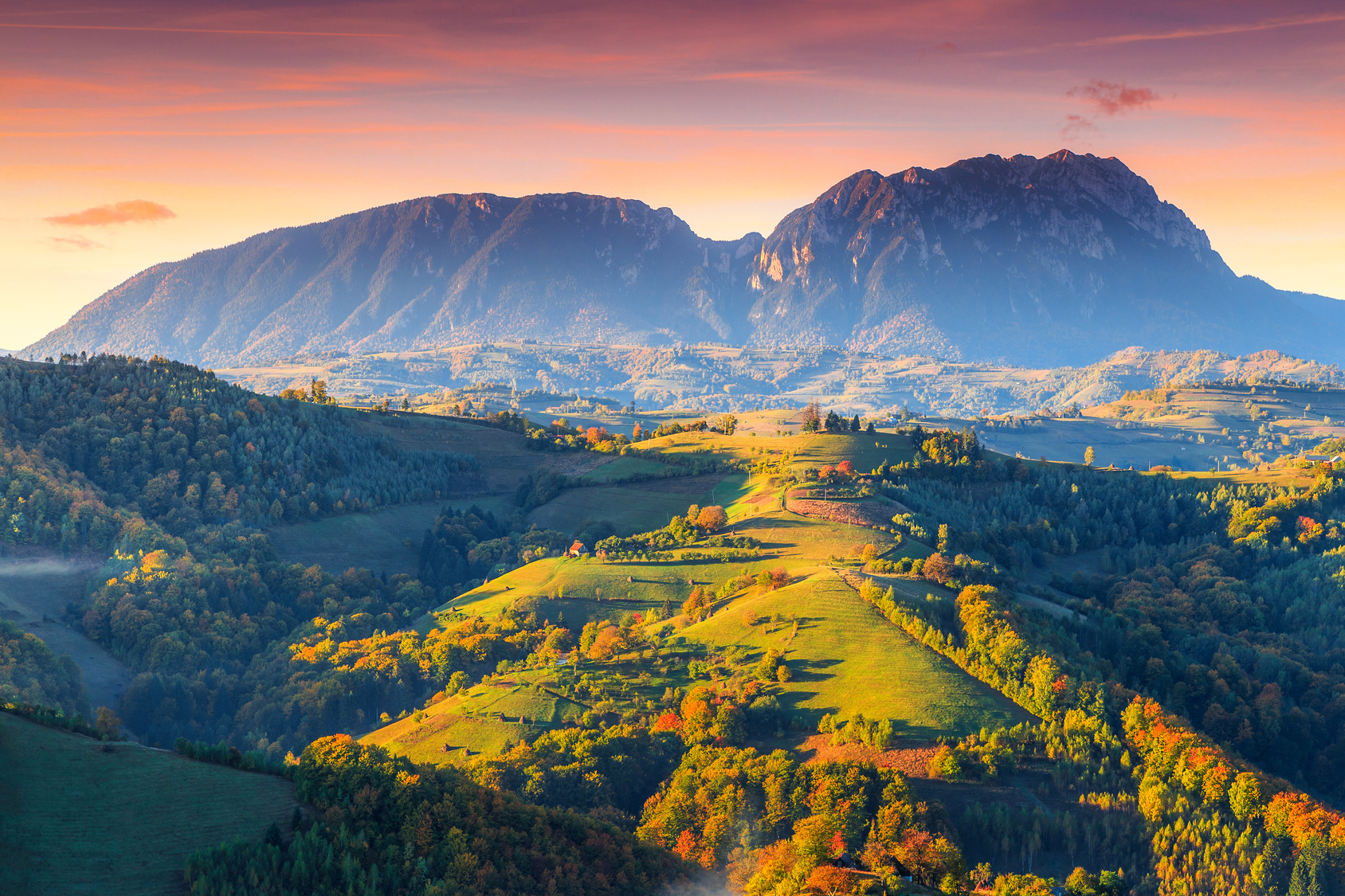 Amazing colorful sunrise with spectacular autumn landscape,Holbav,Transylvania,Romania,Europe