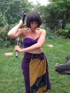 Modeling the bra, ninchucks and sarong.