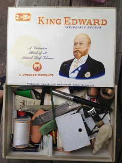 A cigar box of odds and ends.