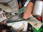 Look at all this stuff. Dry erasers, a rubber mouse, old matches, metal files, makeup brushes, etc.