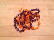 Margi Gras beads. I swear these things reproduce like earthworms. TRASH.