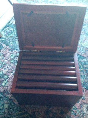 """This is embarrassing. It's a box that holds tiny photo albums. I've had it for years. I was mocked when I got it (I was told that it was """"cheesy"""" and I never even loaded all the pictures up. I'm going to scan the photos and DONATE."""