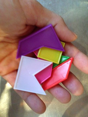 Tiny Tangrams from a Christmas cracker. They sat on my counter. Now they are TRASH.