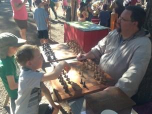 Playing chess, $2