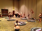 X-stages are set up in the ballroom for pole classes