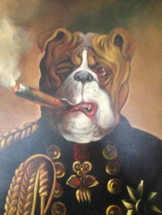 Naturally it is bulldog. And naturally it is smoking a cigar.