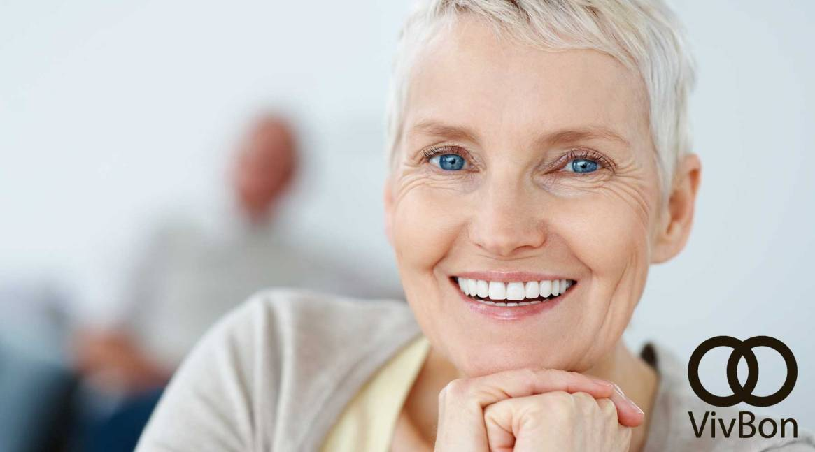 Closeup portrait of a sweet elderly woman smiling
