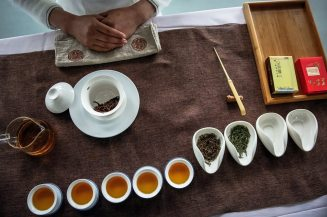A tea art master waits for visitors during a tea expo. By Roman Pilipey.