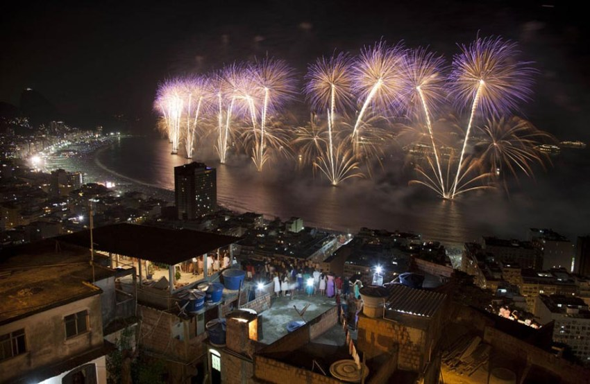 People watch fireworks exploding over Copacabana beach during New Year celebrations at the Pavao Pavaozinho slum in Rio de Janeiro, Brazil, on January 1, 2013.