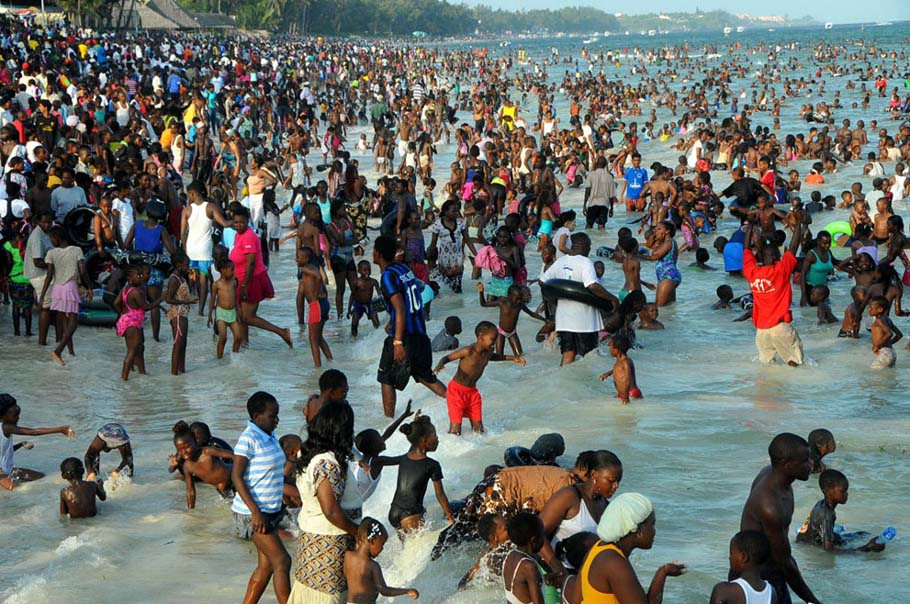 Hundreds of holiday makers at the Jomo Kenyatta Public beach Mombasa, Kenya, on the first day of the year as they ushered in the new year on January 1, 2013. Most of the beaches were in full capacity as the holiday makers spend most of the afternoon session at the beaches either relaxing, swimming or enjoying boat excursions to the deep sea.