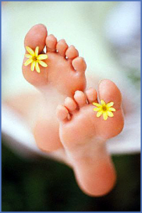 Bathers Feet with Flowers Between Toes