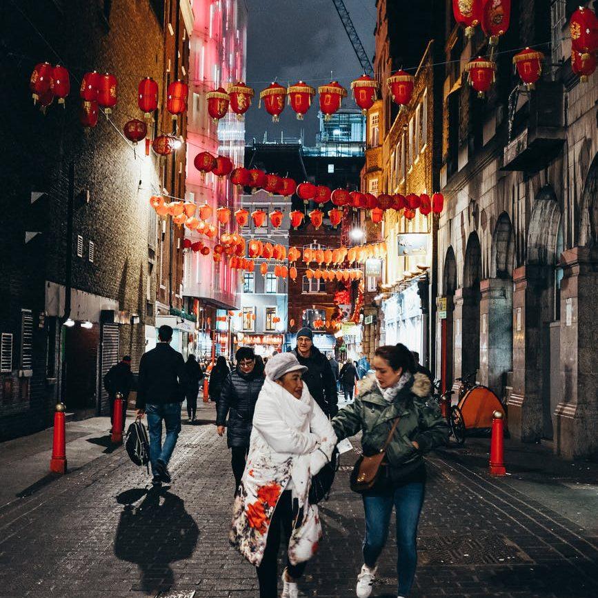 red lantern hanging above the street